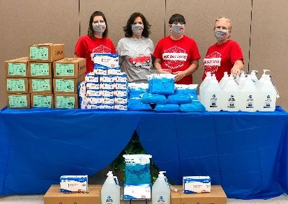 Senior Center Staff with PPE & Shelf-Stable Meals for Distribution