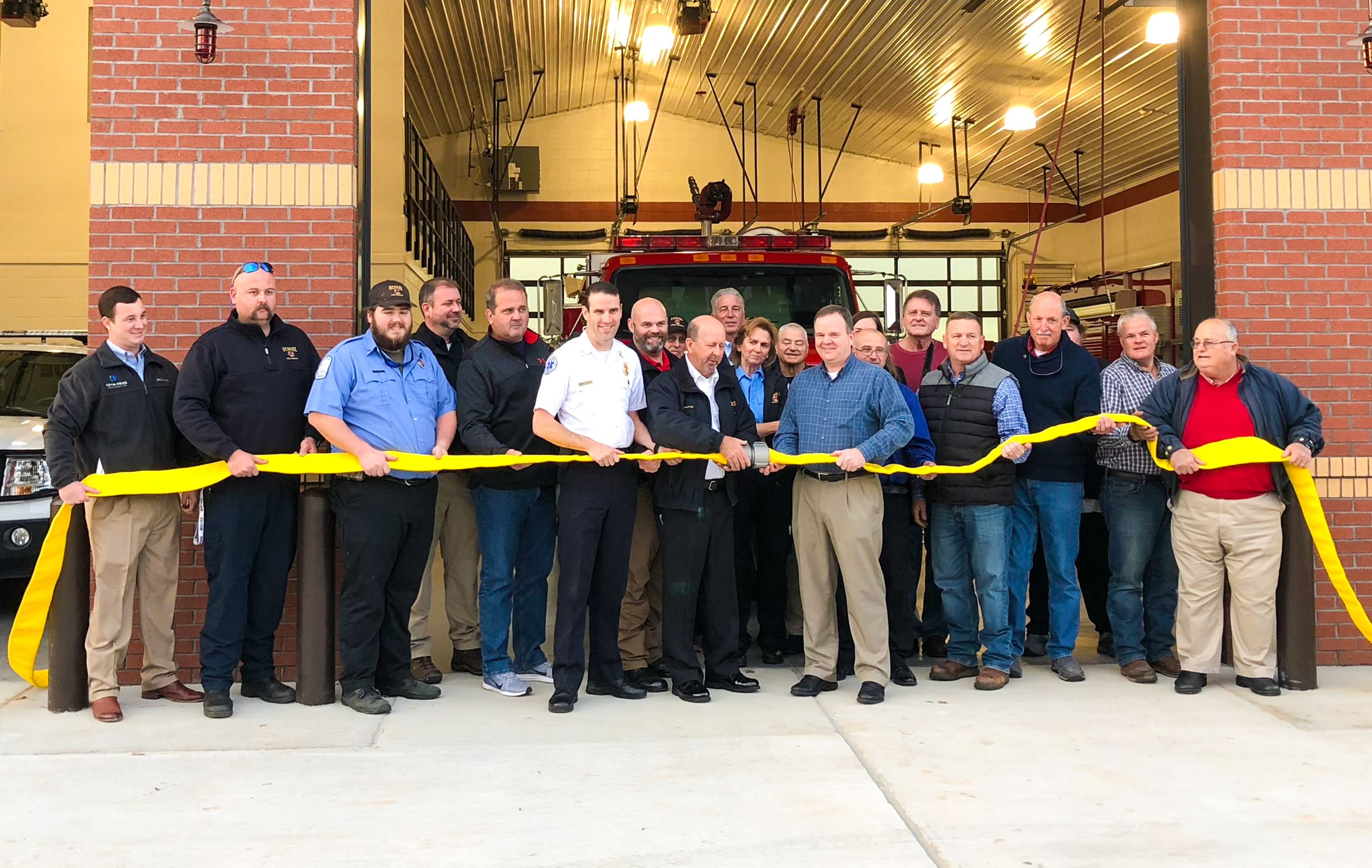 Photo of Oconee County Officials Uncoupling Fire Hose to Dedicate Fire Station 8