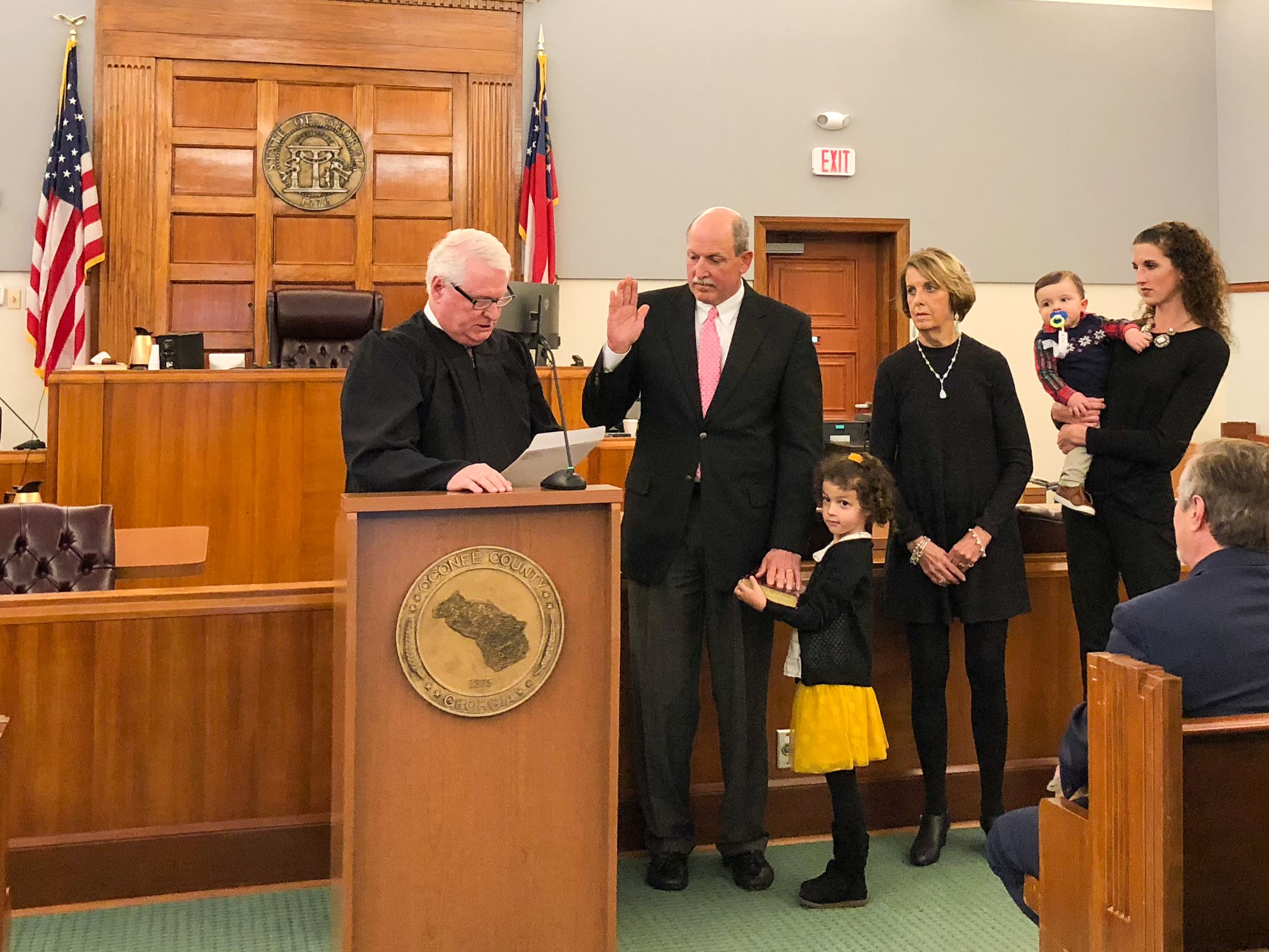 Photo of Commissioner Horton Taking Oath of Office with his Family