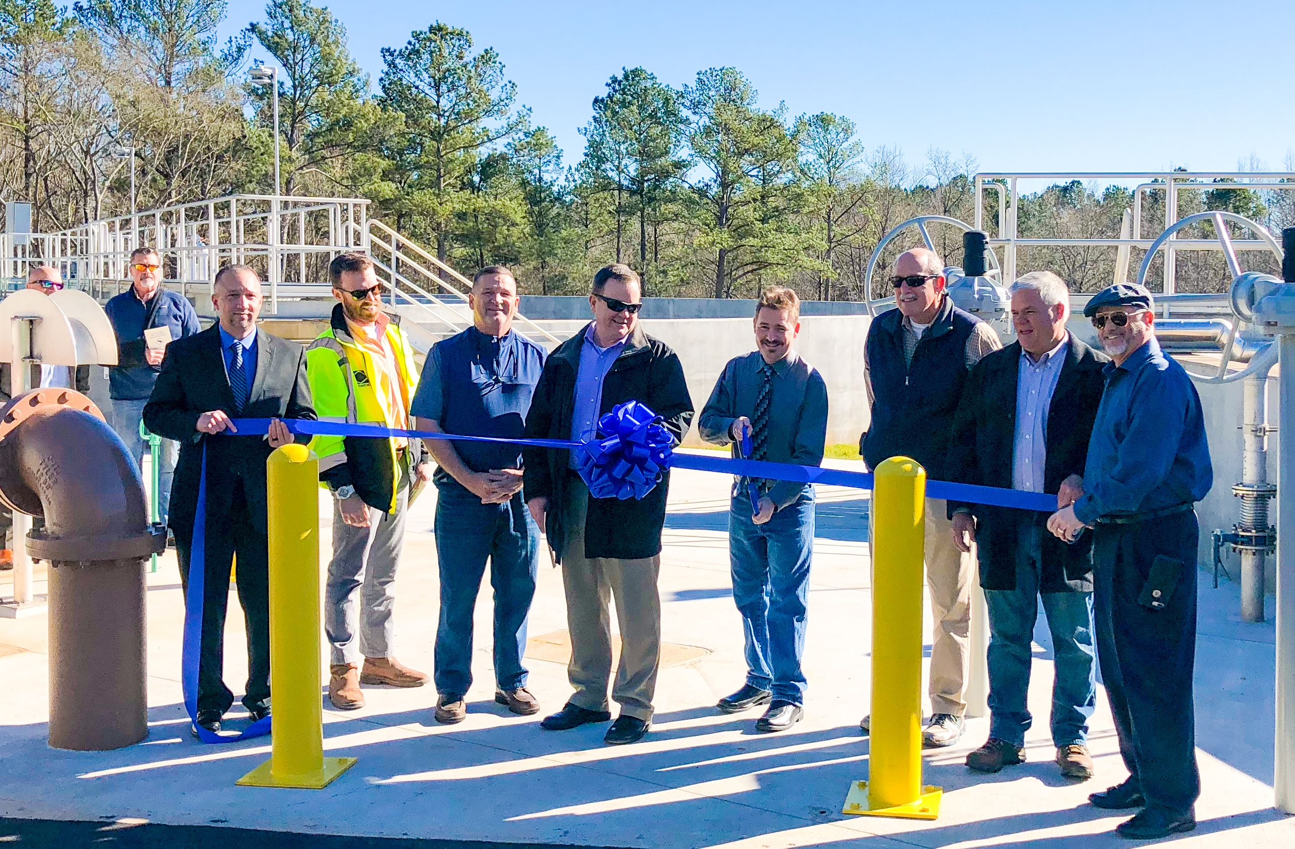 Officials Cutting Ribbon to Open Calls Creek Water Reclamation Facility